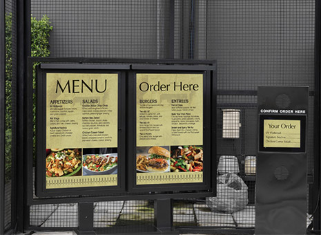 Image of menu boards at a fast food order line