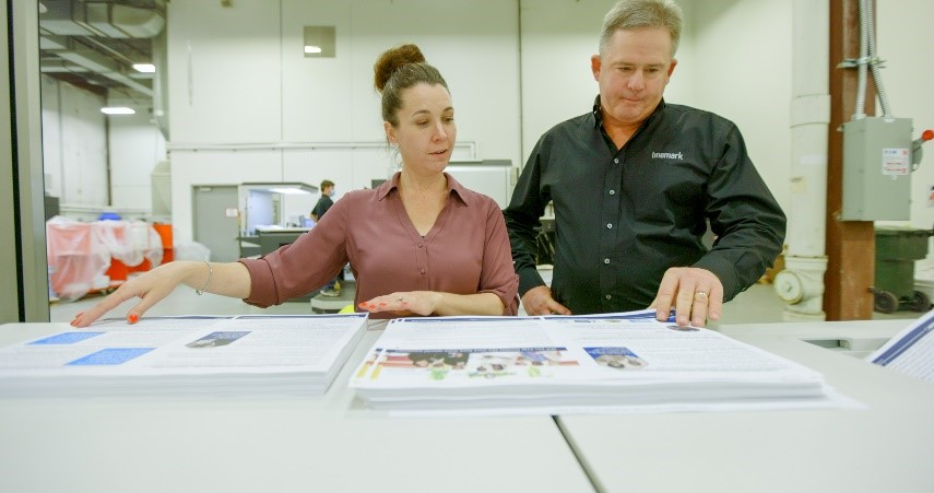 Linemark, Inc. employees looking at application off the varioPRINT iX-series